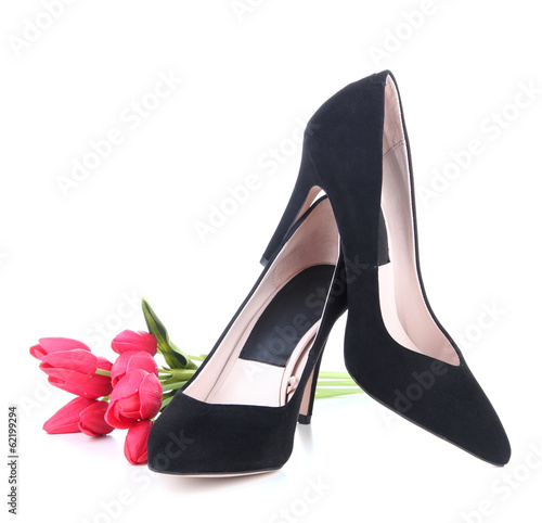Beautiful black female shoes and flowers, isolated on white