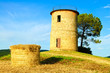 Tuscany, Maremma sunset landscape. Rural tower and tree on hill.