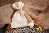 Textile sachet pouch with dried flowers, herbs and berries