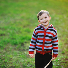 Smiling happy boy - outdoors portrait