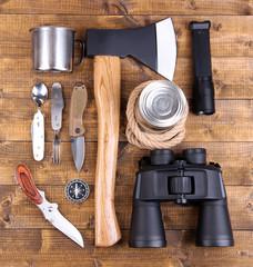 Equipment for trekking on wooden background