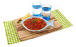 Red caviar in bowl and vodka on wooden board isolated on white