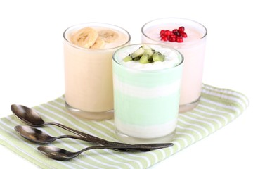 Delicious yogurt with fruits tastes in glasses