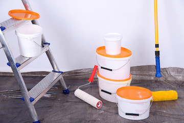 Buckets with paint and ladder
