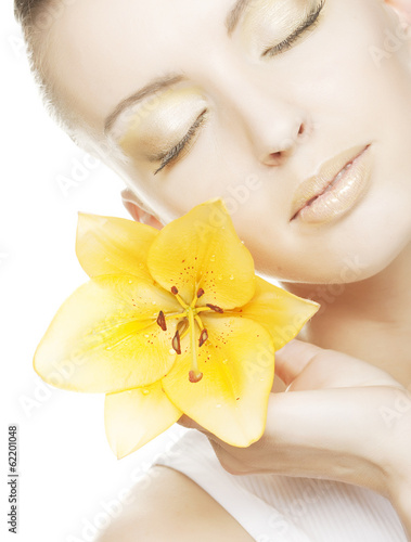 girl holding orchid flower