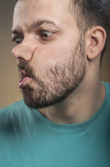 Funny Faces - Man Blowing Against the Glass Surface