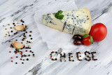 Tasty blue cheese on old wooden table