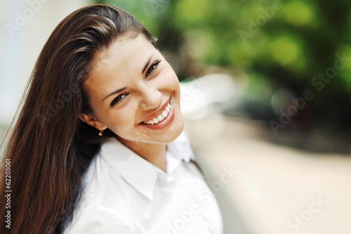 Beautiful happy smiling teen girl - 62203061