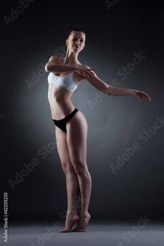 Sensual young model posing in dance pose