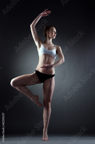 Image of graceful girl posing in dance pose