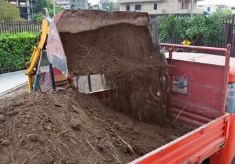 Excavator loading dumper truck tipper