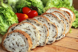 bread sprinkled with sesame -  vegetable green salad
