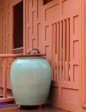 Glazed pottery for water storage on Thai wooden house terrace