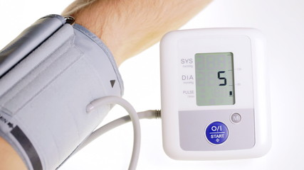 Patient's blood pressure displayed on monitor