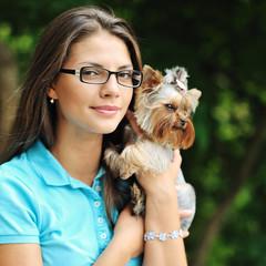 Beautiful girl hugging little dog