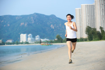 fitness  young woman running seaside