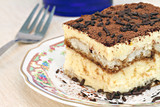 Italian Tiramisu cake macro with selective focus on edge.