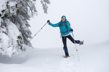 Happy woman snowshoeing