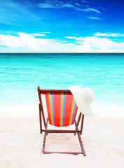 single  wooden sun loungers on white sand