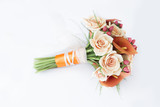 Colorful bouquet of orange calla lilies on a white background
