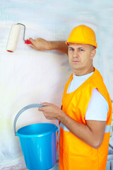 male house painters with paint roller