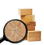 Pile of cardboard boxes isolated and wood inside magnifier glass