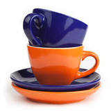 stack of blue and orange tea cups and saucers