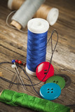 Single blue spool of sewing thread and buttons
