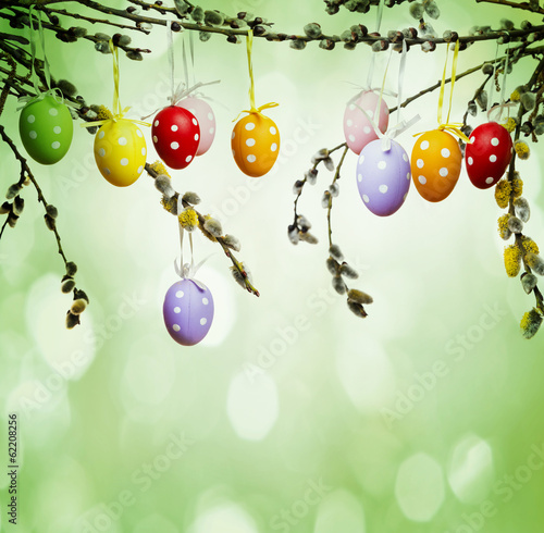 easter still life with painted eggs and spring branch