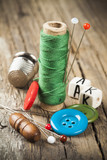 Single green spool of sewing thread