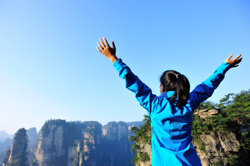 woman hiker open arms at zhangjiajie national forest park
