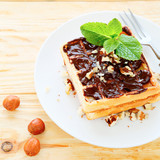 square sweet waffles with chocolate and nuts