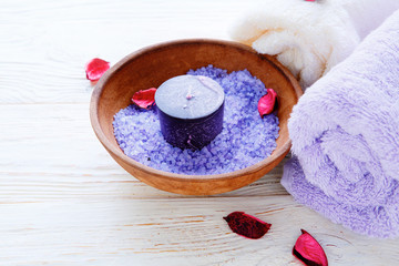 sea ​​salt in a bowl and candle
