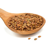 brown lentils in a wooden scoop