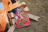 "word ""love"" with ribbon on old wooden valentines day background"