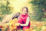 little girl and autumn leaves