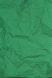 Crumpled  paper background texture green color. Background of kr