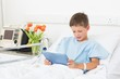 Boy using digital tablet in hospital