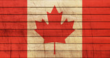 Grunge Canada Flag on wooden texture