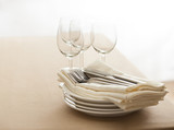 Wine glasses, cutlery, plates and napkins