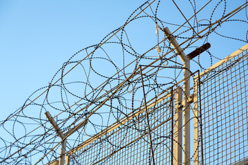 razor wire barbed wire top of security fence