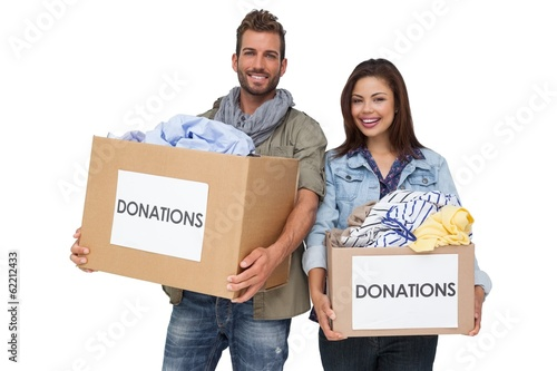 Portrait of a happy young couple with clothes donation