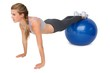 Full length of a fit woman stretching on fitness ball