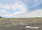 Empty parking lot with blue skies
