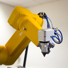 Robotic arm with laser head