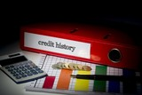 Credit history on red business binder