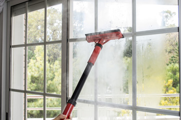 cleaning window with steam