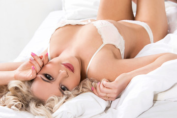 Sexy blonde in bed