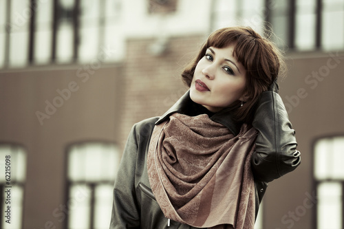 canvas print picture Sad beautiful young woman in leather coat