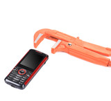 Red and black cell phone with wrench.